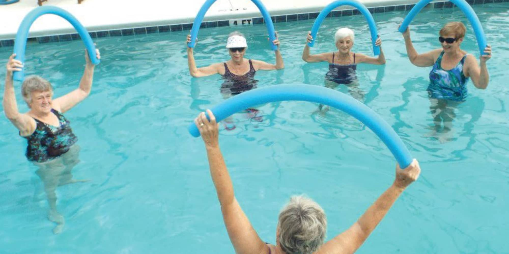 Residents exercising in the pool at Salishan Gracious Retirement Living in Spring Hill, Florida