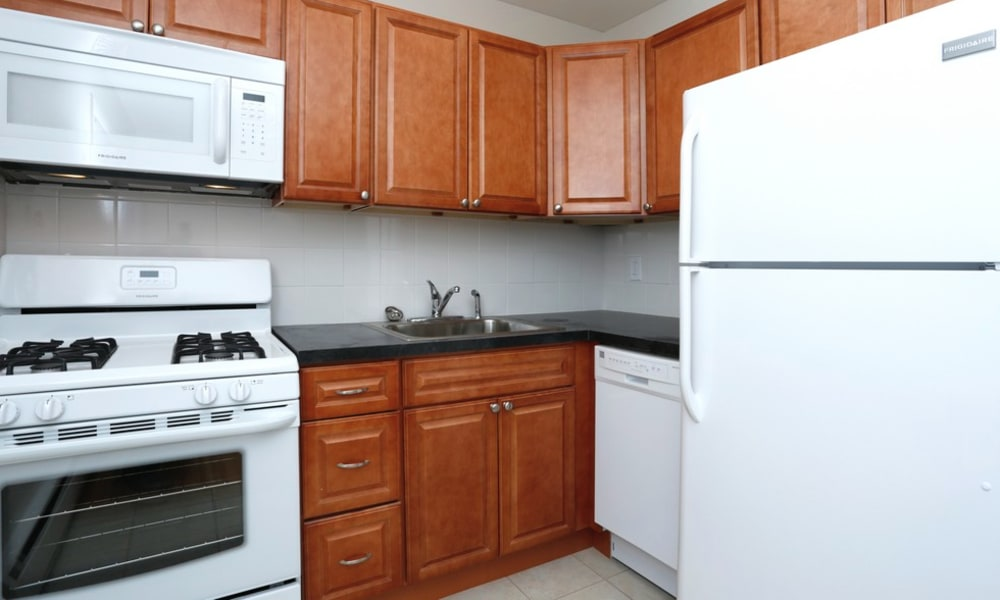Kitchen with white appliances at Eastgate Apartments in Ewing, New Jersey