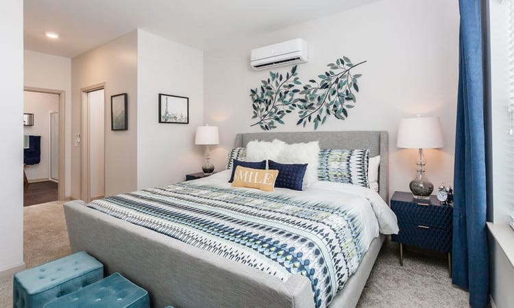 Spacious bedroom at Village Heights Senior Apartments in Fairport, NY