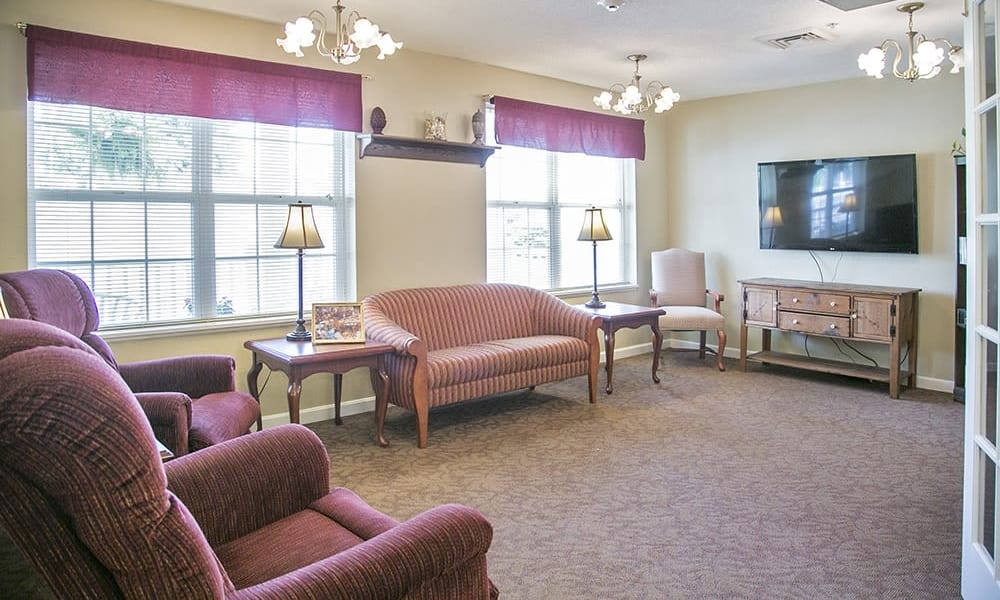 Resident community area with TV and couches at Randall Residence of Wheelersburg in Wheelersburg, Ohio