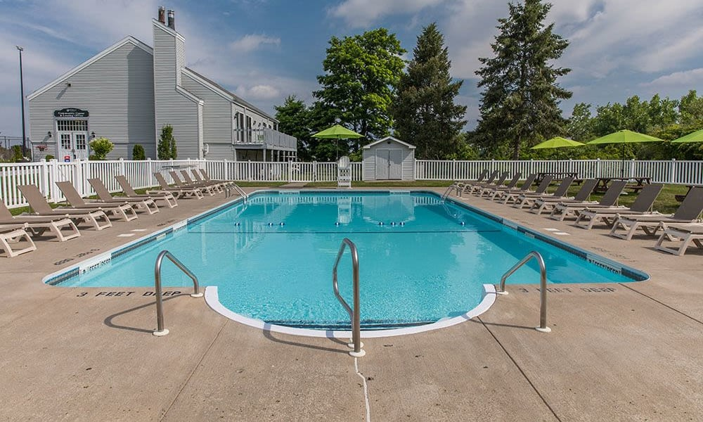 Refreshing pool at The Meadows Apartments in Syracuse, New York