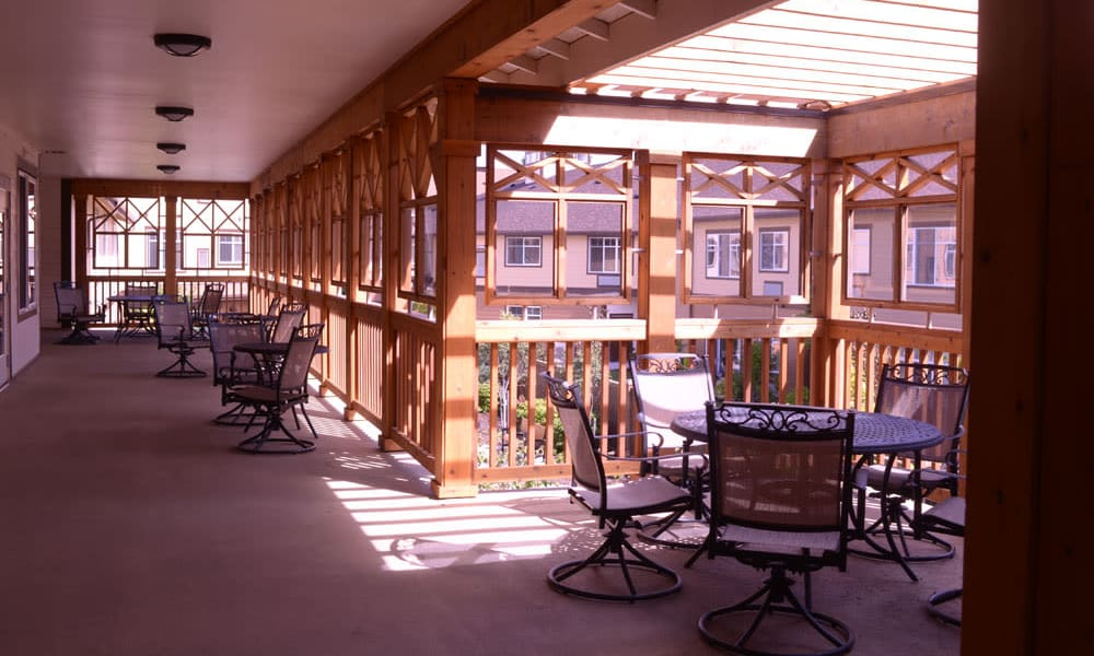 elevated patio overlooking the courtyard at Quail Park of Lynnwood in Lynnwood, Washington
