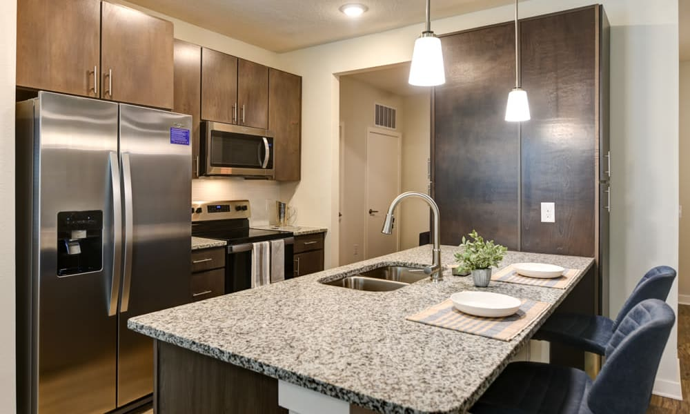 Stylish kitchen with modern amenities at Fusion apartments in Jacksonville, Florida
