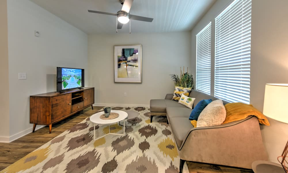 Living room with ceiling fan at Fusion apartments in Jacksonville, Florida