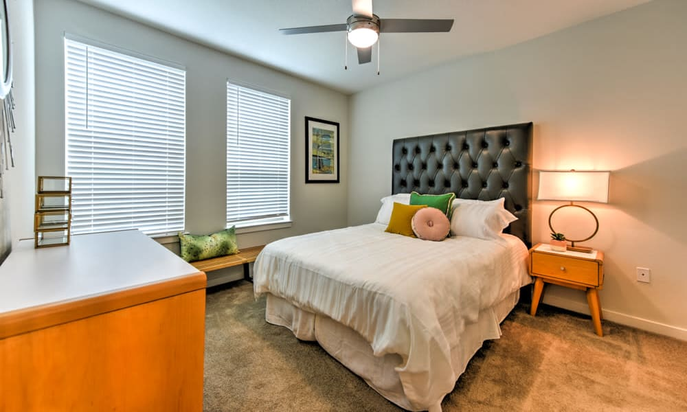 Bedroom featuring ample natural light from large windows in an apartment at Fusion in Jacksonville, Florida