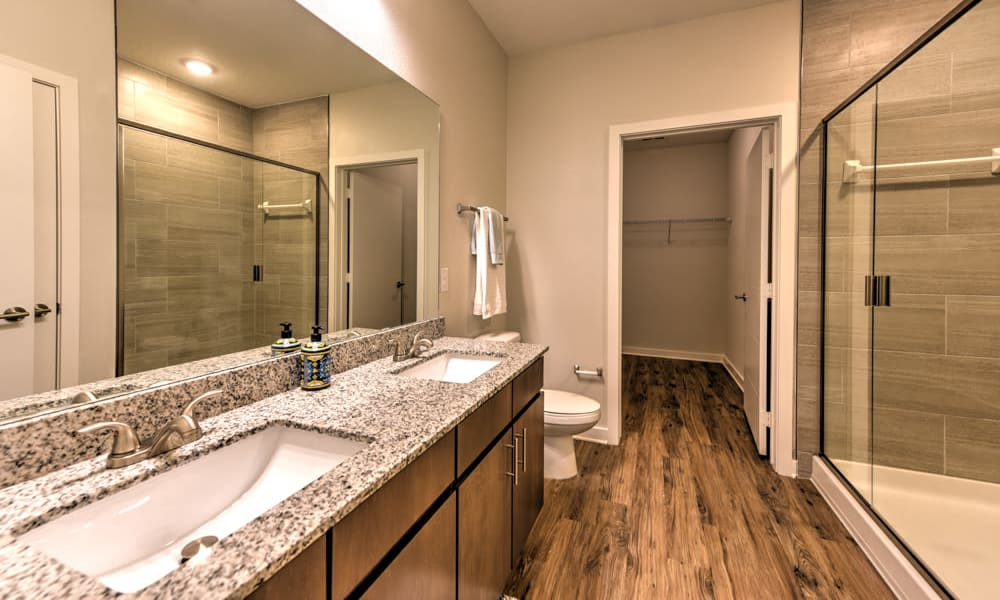 Spacious bathroom with glass door shower at Fusion apartments in Jacksonville, Florida