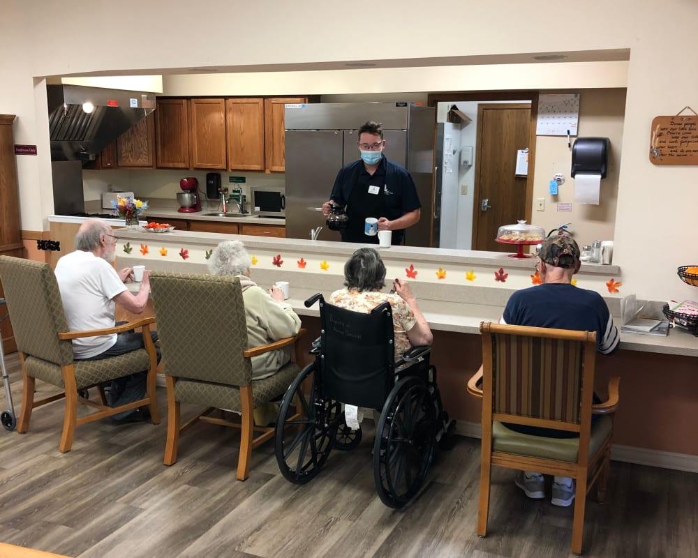 Residents enjoy group coffee breaks at Landings of Sauk Rapids in Sauk Rapids, Minnesota.