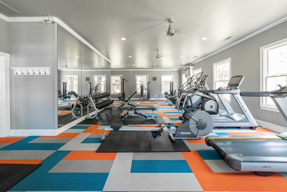 Large fitness room with cardio machines and free weights at Marquis at Bellaire Ranch in Fort Worth, Texas