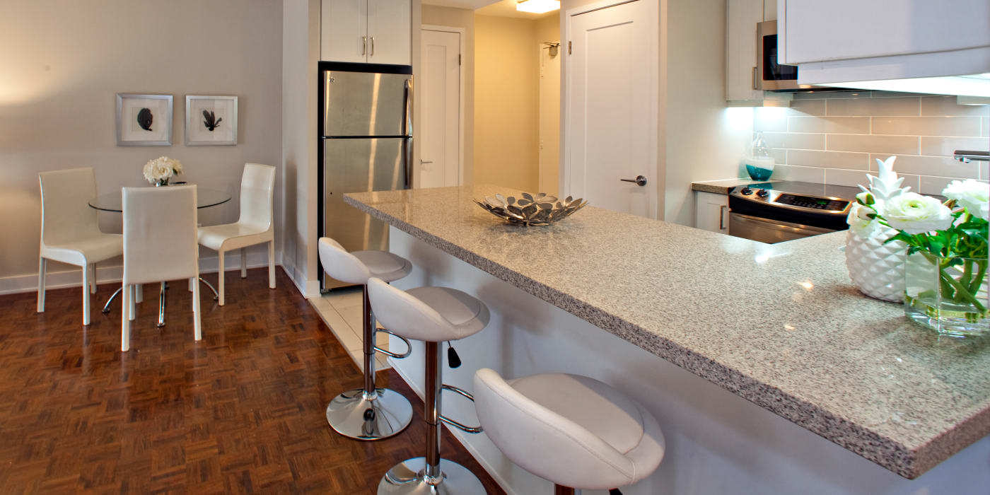Enjoy a luxury kitchen with breakfast bar at Residences on Bloor