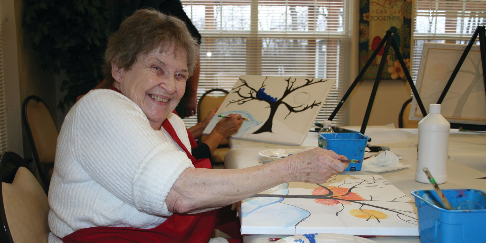 A resident painting at Mulberry Gardens Memory Care in Munroe Falls, Ohio