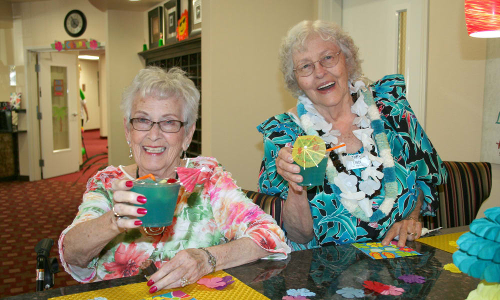 Residents toasting the good life at Ashton Gardens Gracious Retirement Living in Portland, Maine