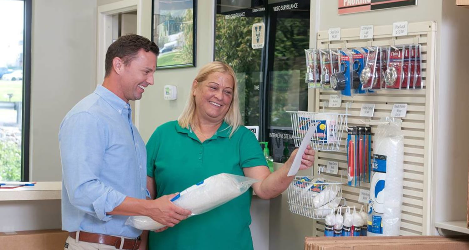A friendly manager helps a customer choose the right tools for her move into Virginia Varsity Storage in Roanoke, Virginia