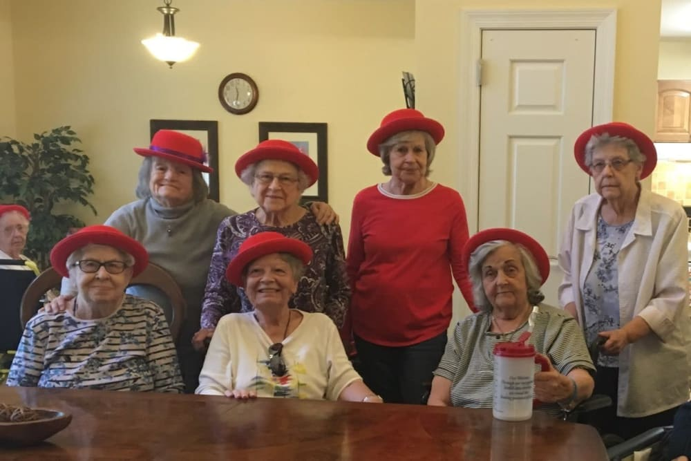 Residents in red hats at The Meadowlands in O'Fallon, Missouri