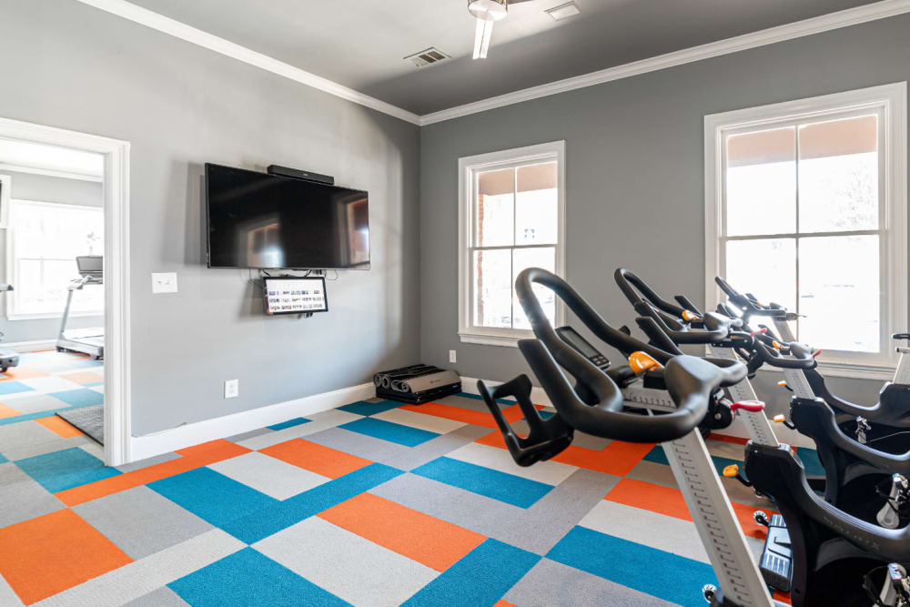 Separate fitness cycle room with tv monitor at Marquis at Bellaire Ranch in Fort Worth, Texas