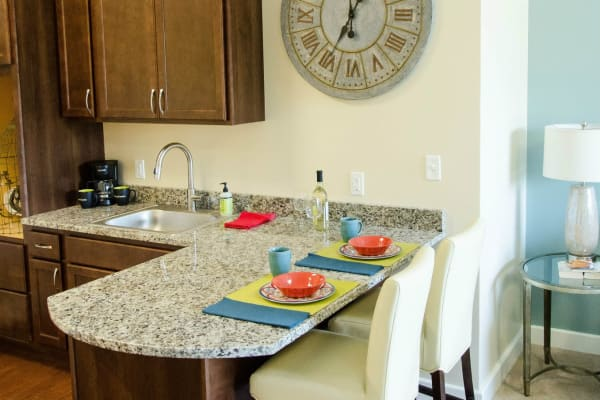Kitchenettes with granite counters available at First & Main of Commerce Township in Commerce Township, Michigan
