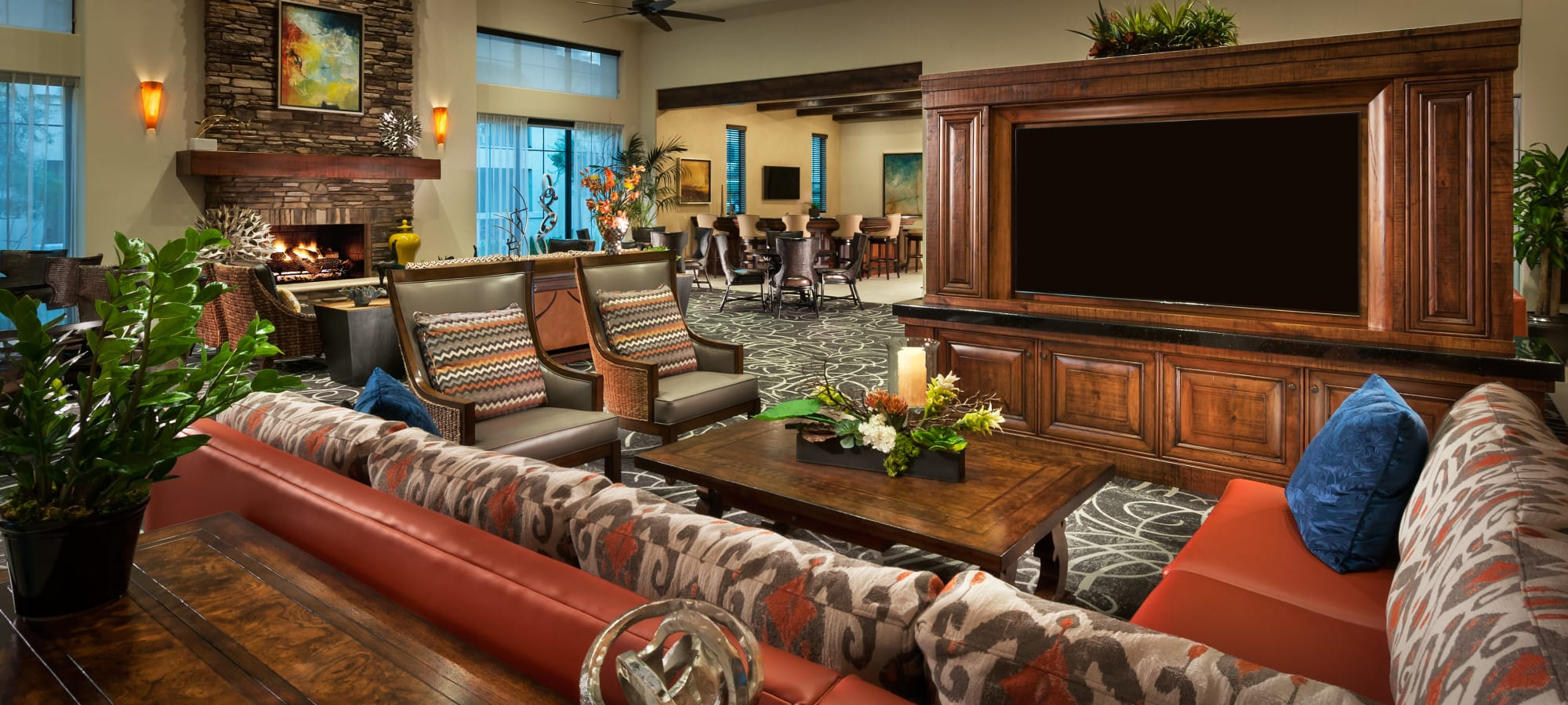 Comfortable seating and large flatscreen TV in the clubhouse at San Milan in Phoenix, Arizona