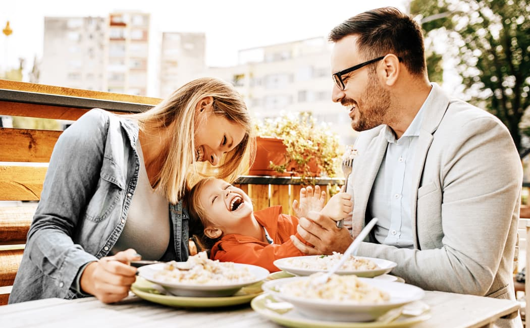 Family Having Breakfast in model home at Willow Oaks Apartments in Chesapeake, VA