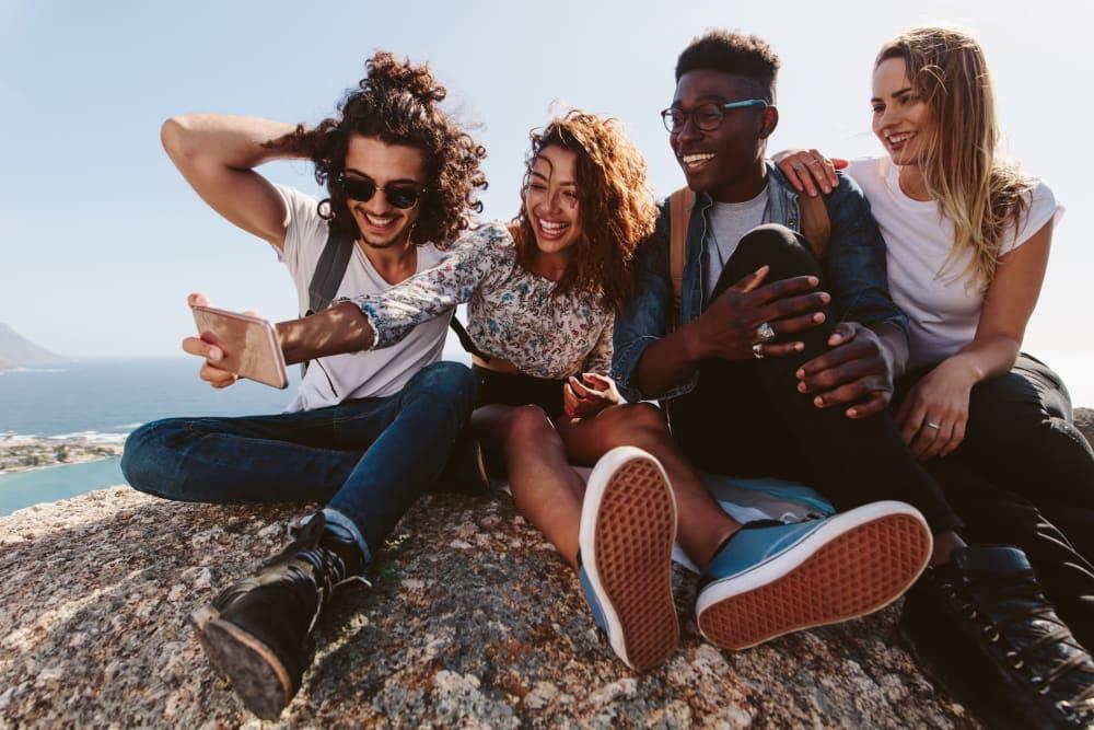 Friends taking a group photo near UNCOMMON Columbus in Columbus, Ohio