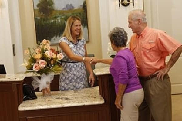 Concierge providing their services to senior citizens at Discovery Commons At Wildewood in California, Maryland.