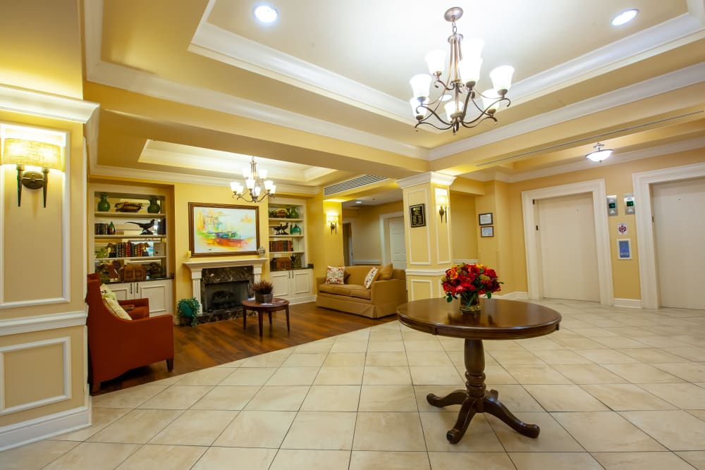 Lobby with seating area at Woodholme Gardens in Pikesville, Maryland.