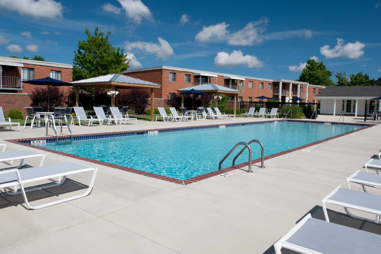 Outdoor swimming pool with sundeck at Colony Club in Bedford, Ohio