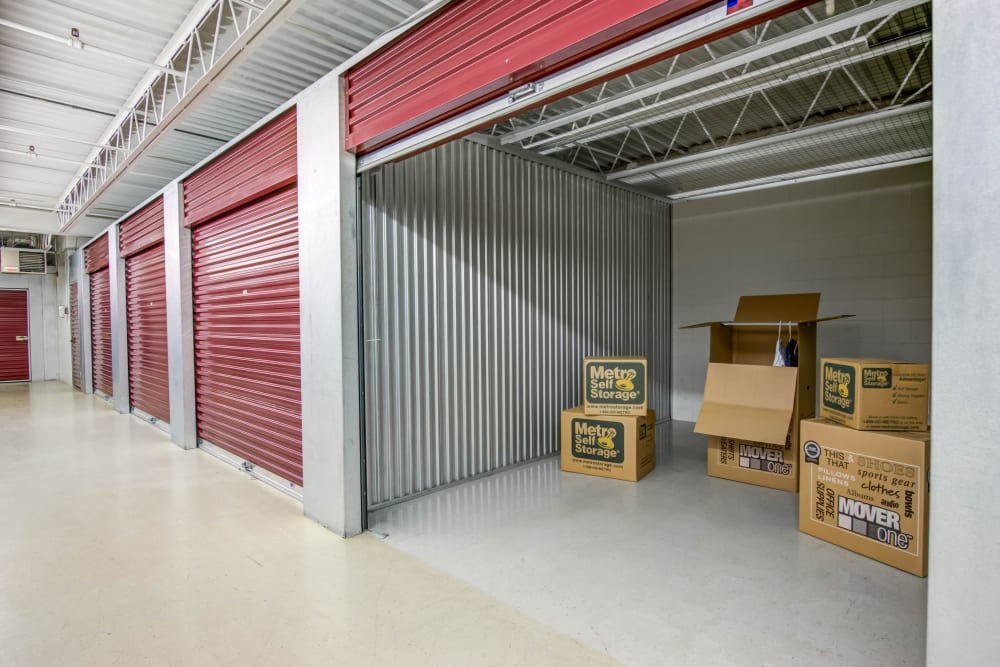 Open unit with packages at Metro Self Storage in Eden Prairie, Minnesota