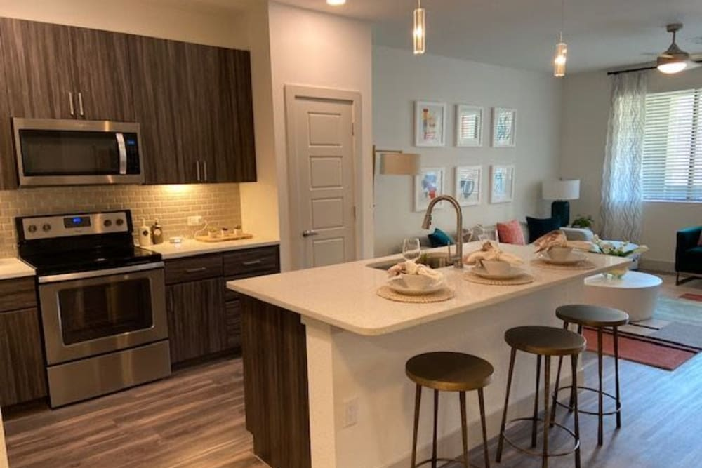 Modern Kitchen With Breakfast Bar At The District at Chandler In Chandler, Arizona