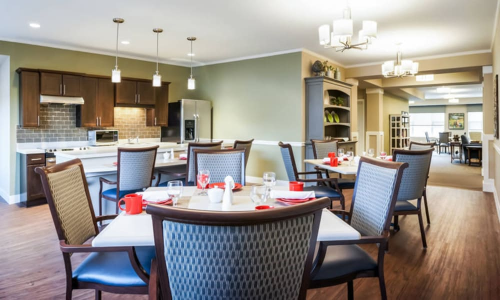 Bistro tables and community kitchenette at The Sanctuary at West St. Paul in West St. Paul, Minnesota