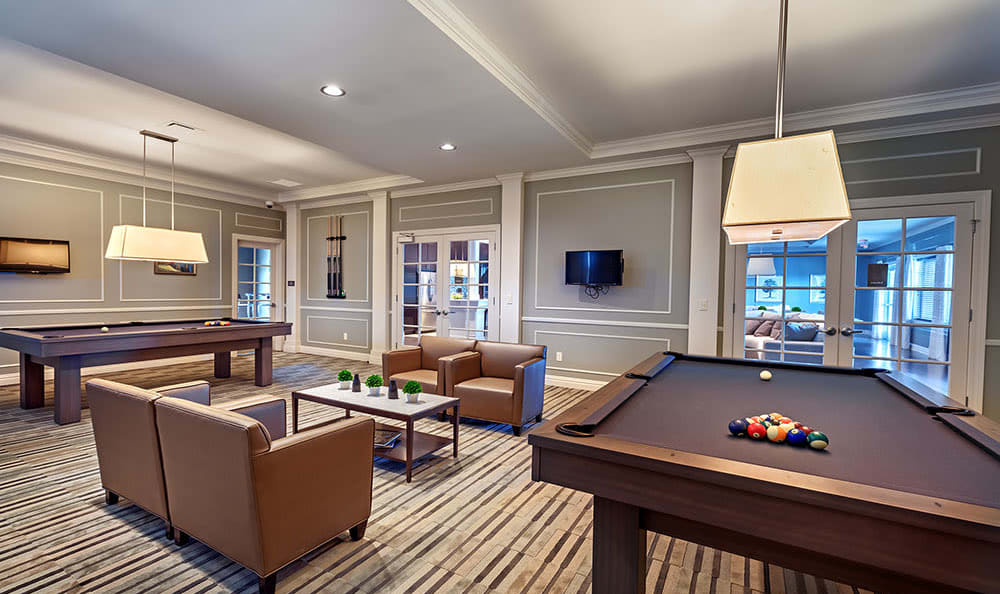 A clubhouse with a pool table that is great for entertaining at Rochester Village Apartments at Park Place in Cranberry Township, PA