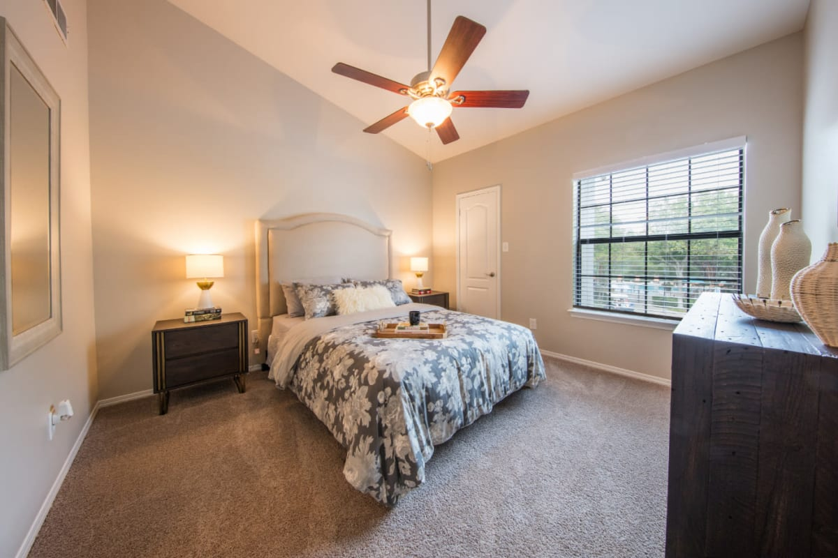 Bright bedroom with carpet flooring at Marquis at Treetops in Austin, Texas