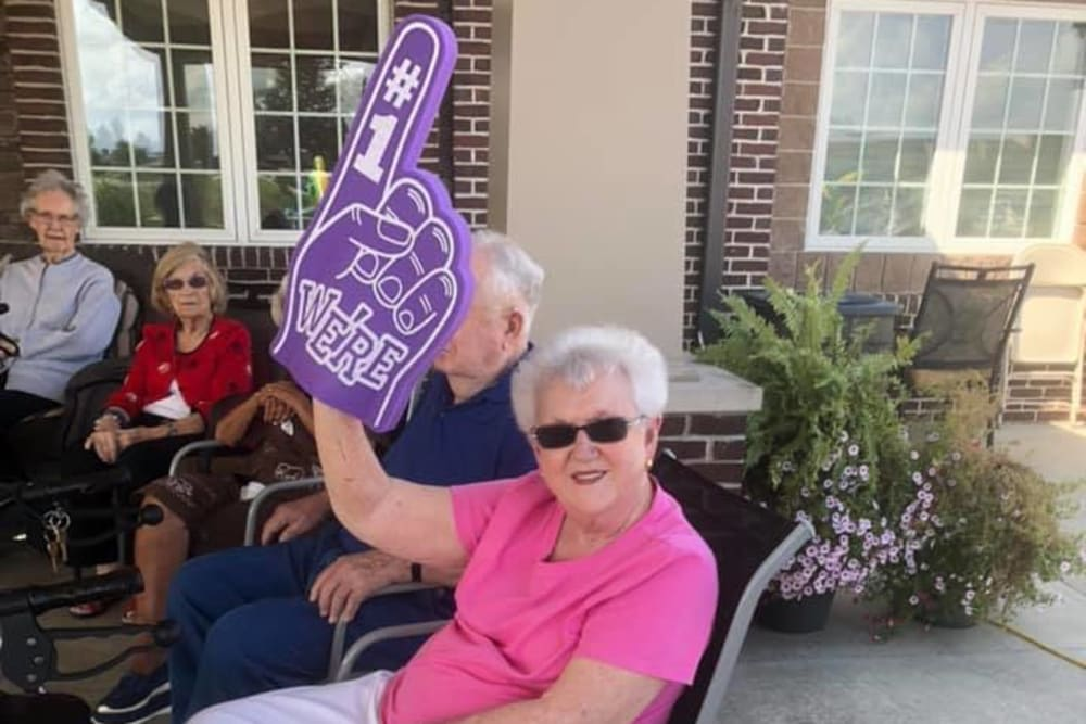 A resident with a foam finger at Villas of Holly Brook Shelbyville in Shelbyville, Illinois