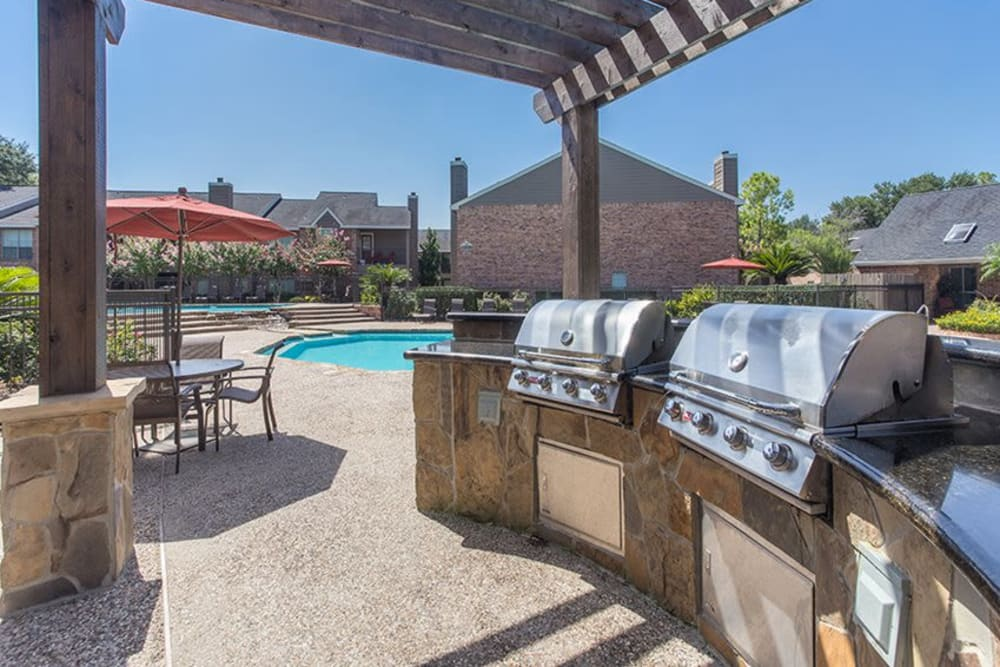 BBQ grill area by pool at Broadstone Briar Forest in Houston, Texas