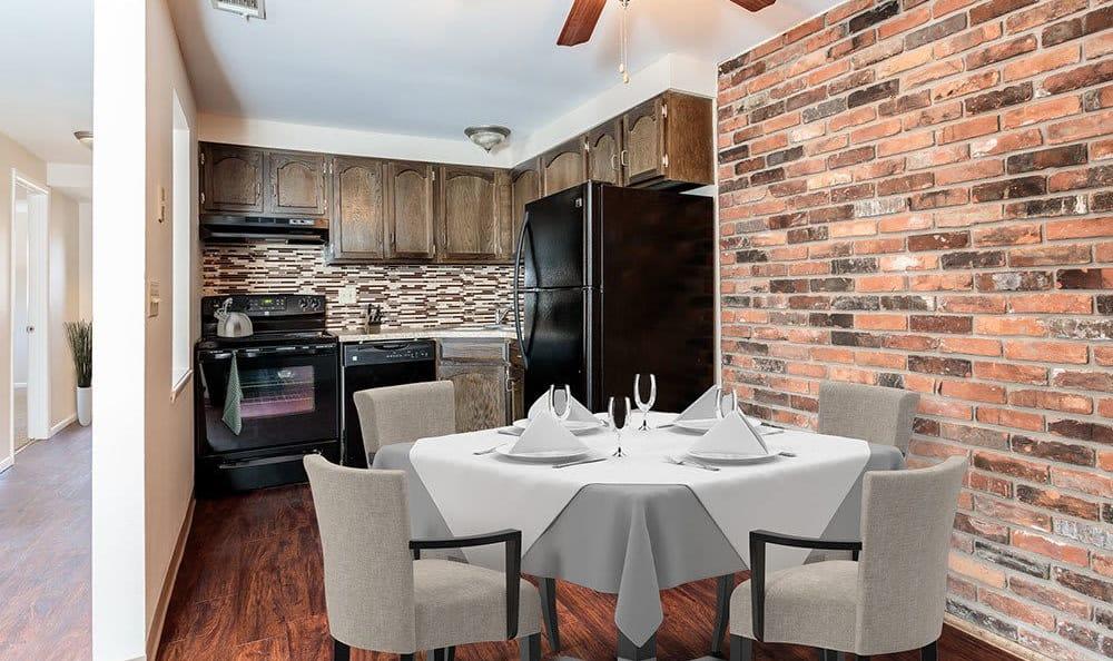 Dining room and kitchen at Raintree Island Apartments in Tonawanda, NY
