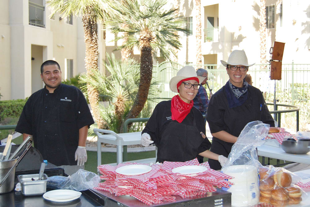 Team members enjoying a BBQ party at Merrill Gardens at Green Valley Ranch in Henderson, Nevada