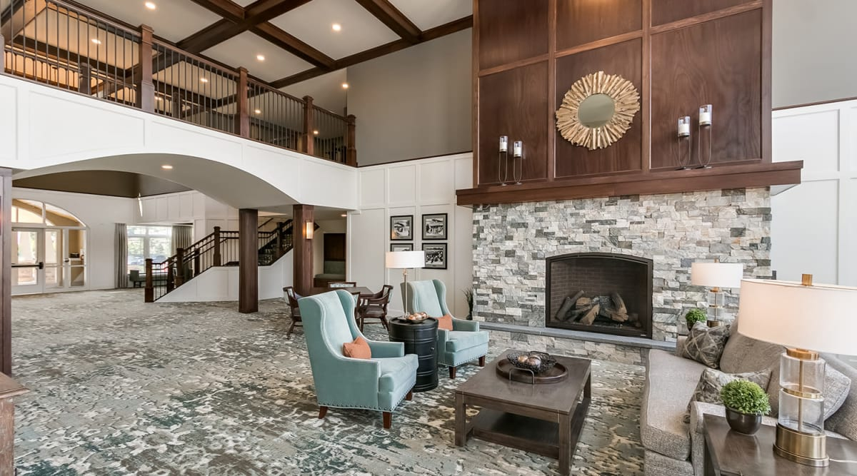 Lobby with a fireplace at Applewood Pointe of Apple Valley in Apple Valley, Minnesota.