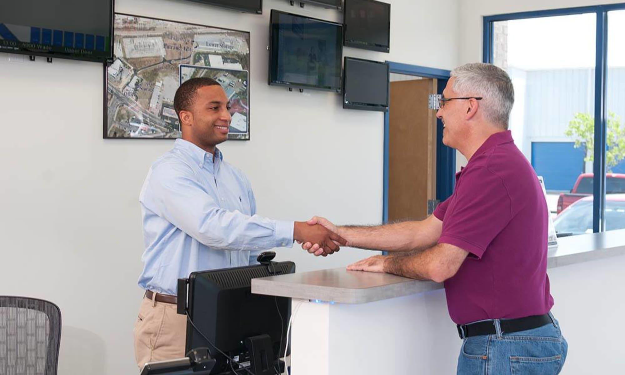 Friendly manager helps a customer at Virginia Varsity Storage in Salem, Virginia
