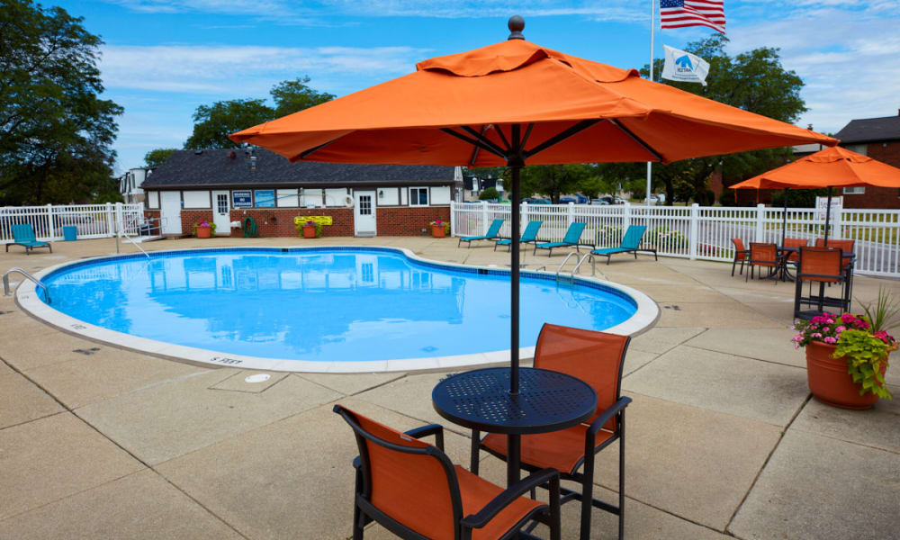 Swimming pool on a sunny day at Maple Creek Apartments in Sterling Heights, Michigan