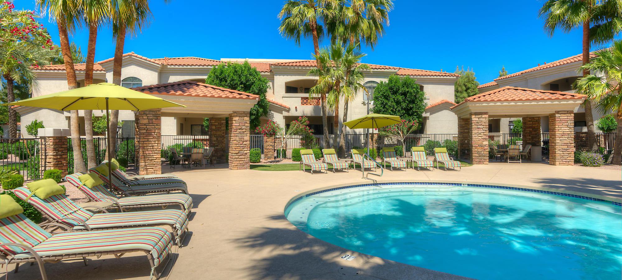 Lounge chairs surround the resort-style swimming pool at San Prado in Glendale, Arizona