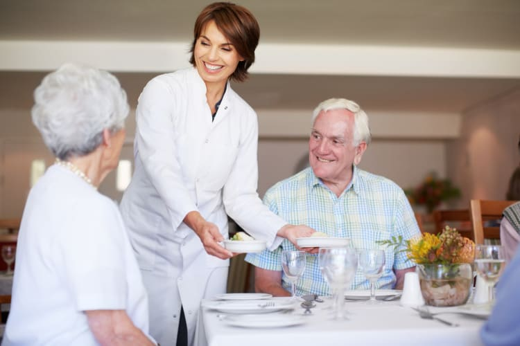 Elderly couple having dinner at Traditions of Cross Keys