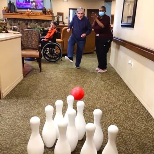 Residents bowling at Oxford Glen Memory Care at Grand Prairie in Grand Prairie, Texas
