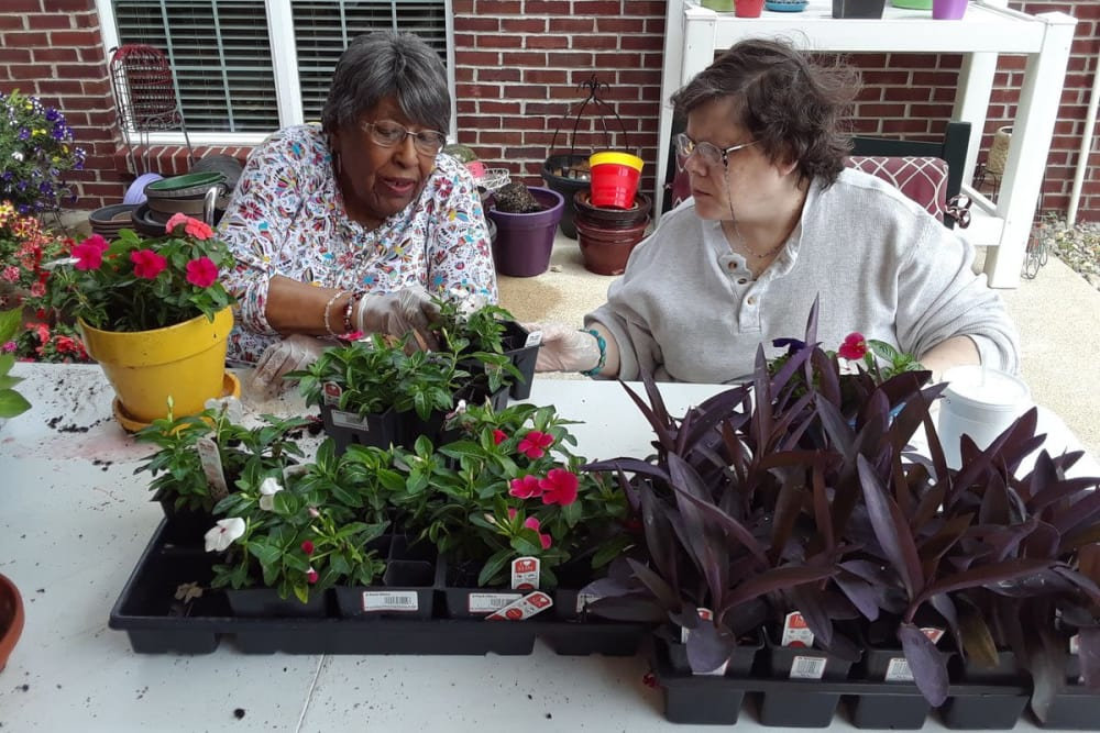 Two residents gardening at Ashford Place Health Campus in Shelbyville, Indiana
