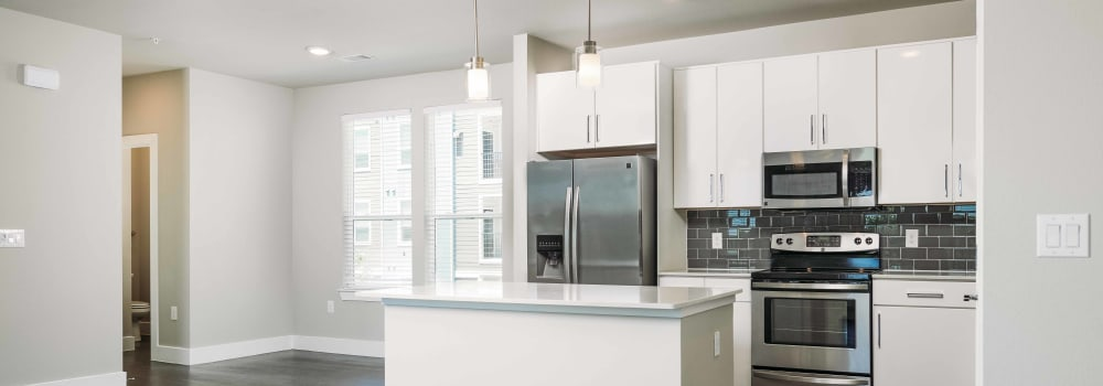 An open kitchen with white cabinetry at Greenhouse in Houston, Texas