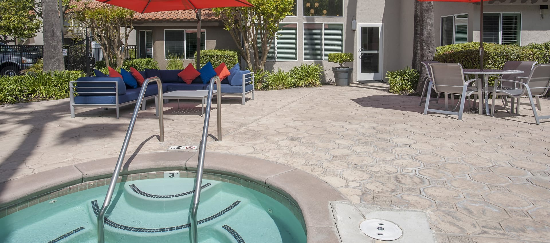 Resident hot tub with outdoor lounge area at Shore Park at Riverlake in Sacramento, California