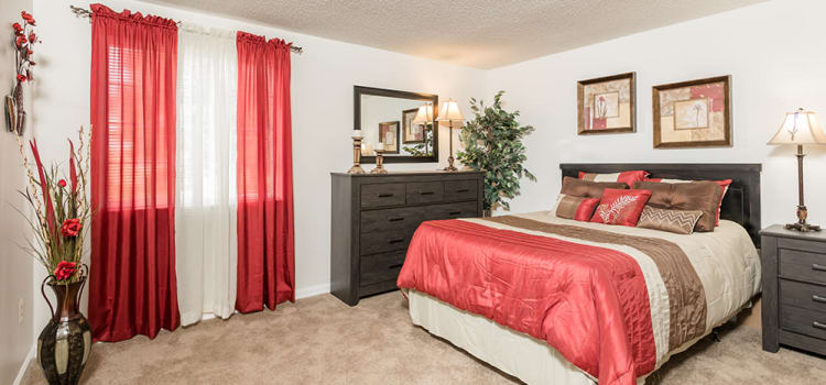 Well decorated bedroom at Maplewood Estates Apartments home in Hamburg, New York