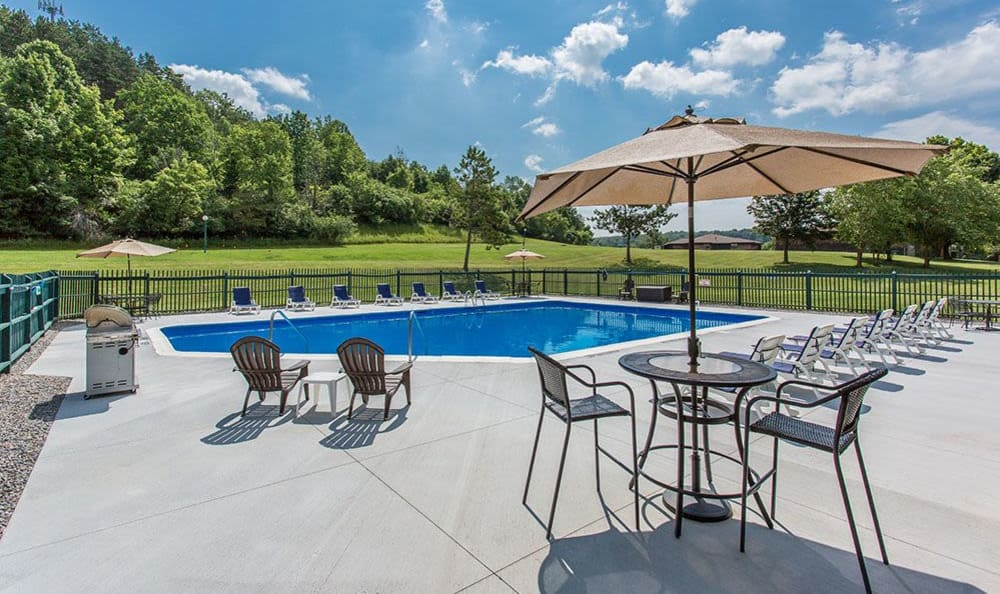 Sparkling swimming pool at Steeplechase Apartments in Camillus