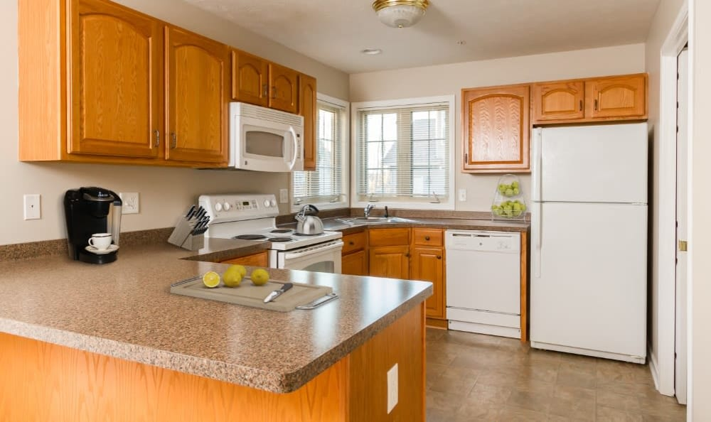 Well equipped kitchen at North Ponds Apartments home in Webster
