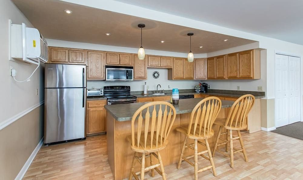 Dining area and upgraded kitchen view at High Acres Apartments and Townhomes in Syracuse, NY