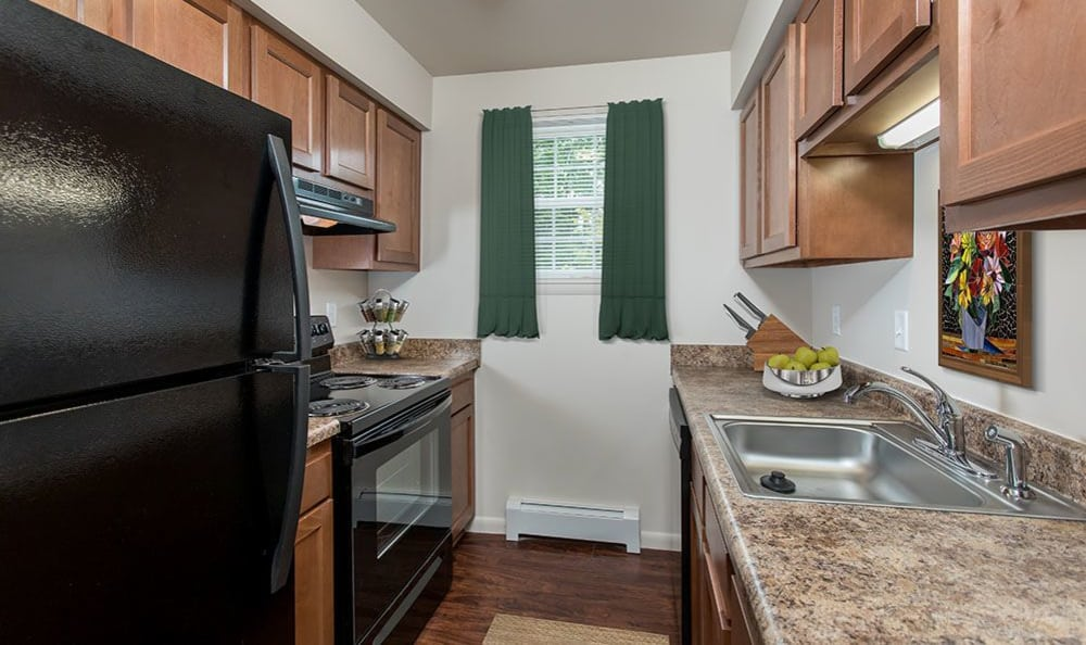 Fully-equipped kitchen at Orchard Estates in Mattydale
