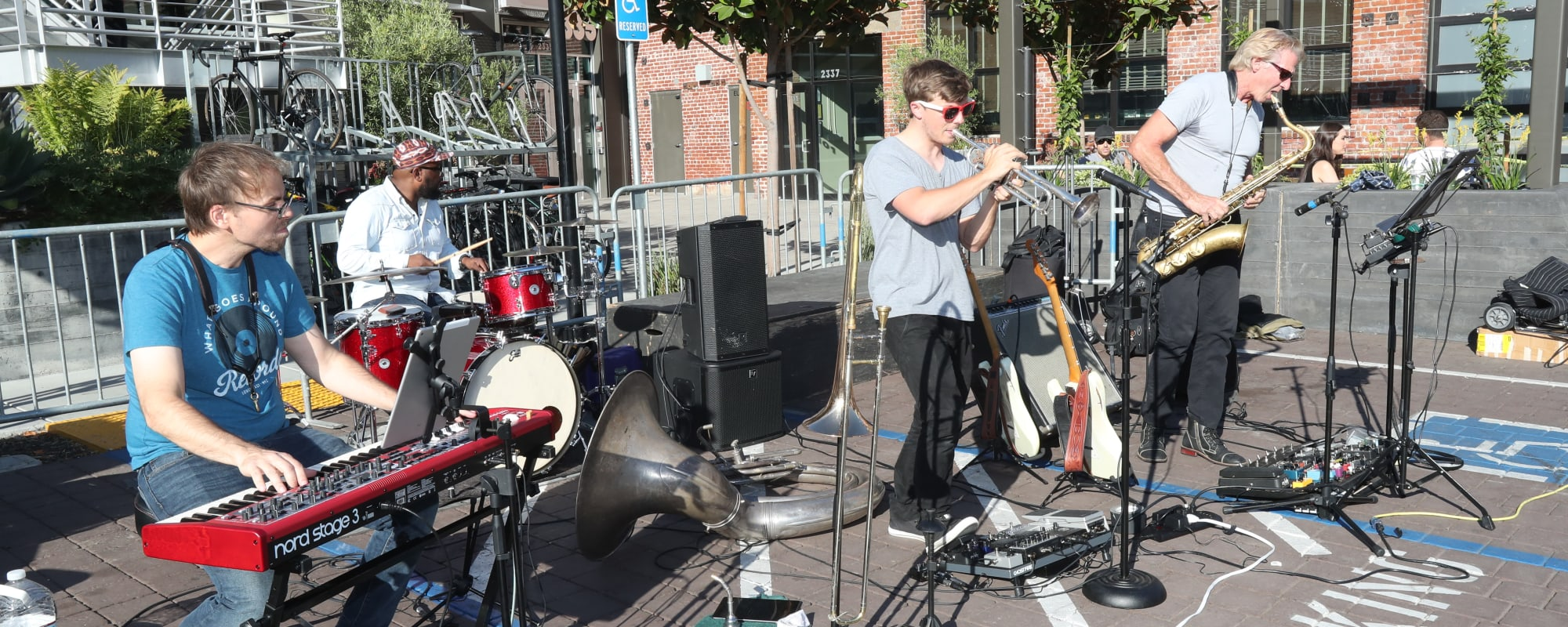 Musicians playing near The Moran in Oakland, California