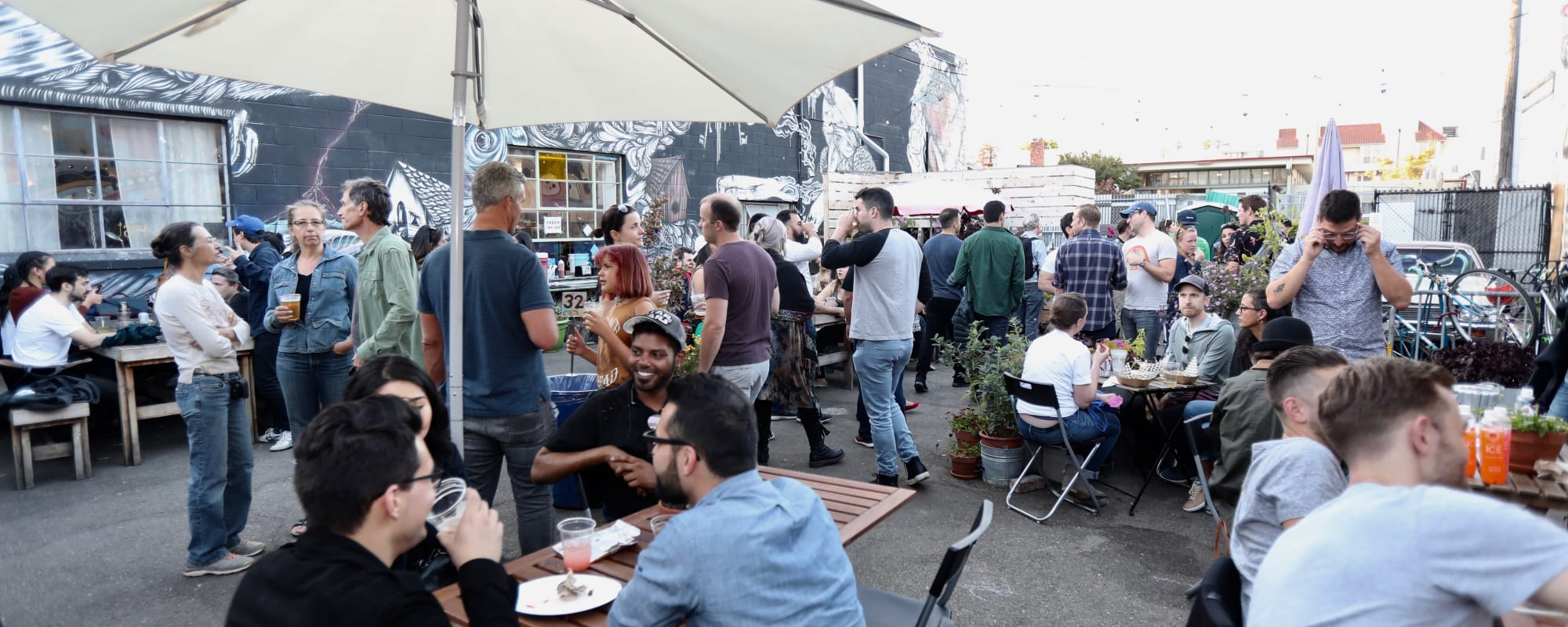 Folks gathering and eating near The Moran in Oakland, California